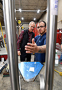 Illinois Governor Bruce Rauner visited Mac Medical in Millstadt, Illinois on Friday March 23 as part of his statewide tour to kick off his general election campaign. Rauner toured the facility, which manufactures medical equipment in its 100,000 square foot facility. Employee Tadeo Avila (right) of Fairmont City, the lead TIG (tungsten inert gas) welder at Mac Medical, shows Rauner a medical shelf under construction at his workstation.