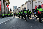 """Territorial Support Group unit rush towards a group of protestors who formed a line of resistance in Trafalgar Square during a """"Resist and Act for Freedom"""" protest against a mandatory coronavirus vaccine, wearing masks, social distancing and a second lockdown, nearby Canada House in Trafalgar Square, London on Saturday, Sept. 19, 2020. The event, which began at noon, drew a broad coalition including coronavirus sceptics, 5G conspiracy theorists and so-called """"anti-vaxxers"""". Speakers at the event accused the government of attempting to curtail civil liberties. (VXP Photo/ Vudi Xhymshiti)"""