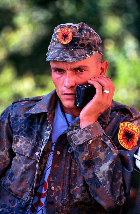 KLA fighter listening to the news, Prizren, Kosovo. 1999