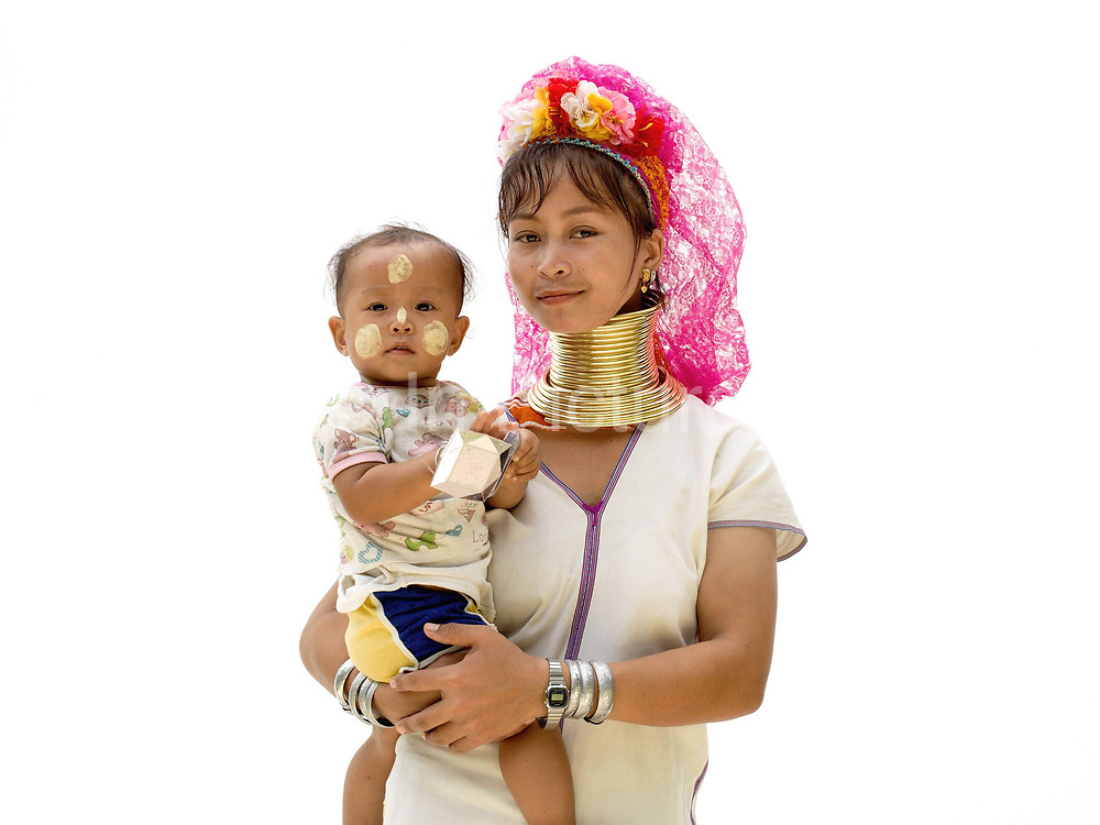 Ma Su 20 an ethnic Kayan woman and her baby daughter from Myanmar at Baan Tong Luang, Eco-Agricultural Hill Tribes Village on 7th June 2016 in Chiang Mai province, Thailand. The fabricated village is home to 8 different hill tribes who make a living from selling their handicrafts and having their photos taken by tourists