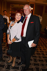 JOHN JACKSON and actress RUTH MADOC at the 90th birthday party for Nicholas Parsons held at the Hyatt Churchill Hotel, Portman Square, London on 8th October 2013.