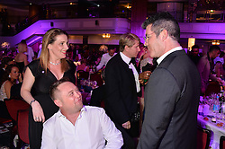 Left to right, SAM BAILEY, her husband CRAIG BAILEY and SIMON COWELL at the Caudwell Children's annual Butterfly Ball held at The Grosvenor House Hotel, Park Lane, London on 15th May 2014.