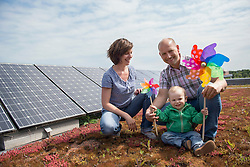 Young family wind solar power environmental issues