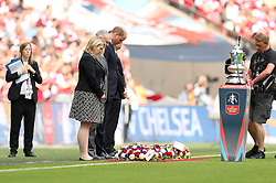 The Duke of Cambridge lays down the reef for a minutes silence prior to the Emirates FA Cup Final at Wembley Stadium, London.
