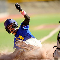 Zuni Thunderbird Adan Benavidez (8) slides home to score a in-the-park grand slam on the Newcomb Skyhawks during the Wingate Baseball Slam tournament at Ford Canyon Park in Gallup Friday.