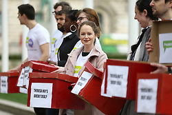 "© Licensed to London News Pictures. 14/01/2019. London UK. Activists from the People's Vote campaign are in Parliament Square this morning unveiling 'Deal or No Deal' boxes. On the outside, the boxes say ""Theresa May's Brexit deal?"", and on the inside they say ""People's Vote"".Photo credit: Andrew McCaren/LNP"
