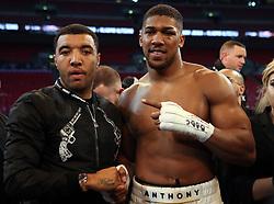 Anthony Joshua post fight Watford striker Troy Deeney following the IBF, WBA and IBO Heavyweight World Title bout against Wladimir Klitschko at Wembley Stadium, London.