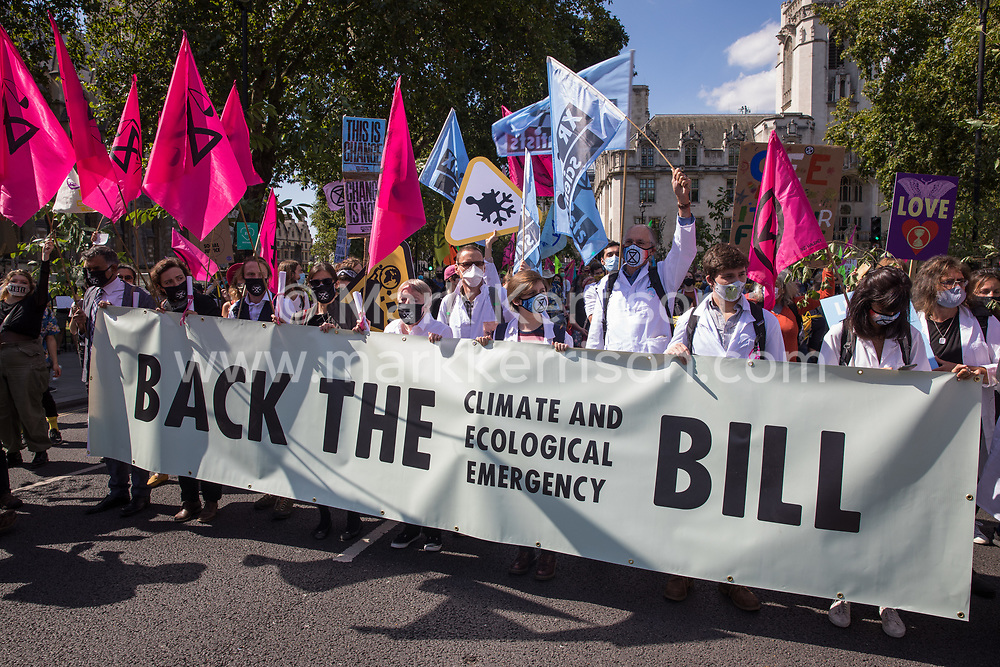 London, UK. 1st September, 2020. Climate activist scientists from Extinction Rebellion hold a banner calling for support for the Climate and Ecological Emergency Bill (CEE Bill) during a Back The Bill rally. Extinction Rebellion activists are attending a series of September Rebellion protests around the UK to call on politicians to back the CEE Bill which requires, among other measures, a serious plan to deal with the UK's share of emissions and to halt critical rises in global temperatures and for ordinary people to be involved in future environmental planning by means of a Citizens' Assembly.