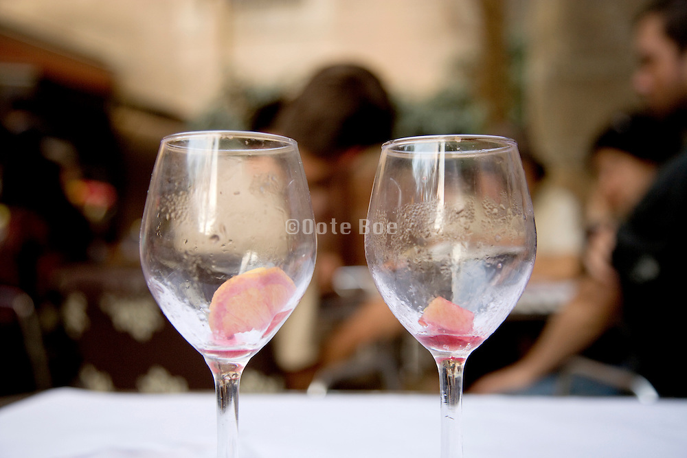 two empty wine glasses with left over fruit from sangria