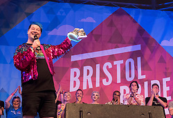 © Licensed to London News Pictures; 10/10/2020; Bristol, UK. Queen's Birthday Honours 2020; File picture dated 13/07/2019 of DARYN CARTER, Director and Programmer for Bristol Pride, who has been awarded an MBE for services to the LGBTQ+ community in Bristol. He was due to step down in 2019 but has stayed to help steer the charity through the challenges of Covid-19. Mr Carter helped plan and deliver an online festival this year after the public event was cancelled because of the coronavirus pandemic. Daryn Carter is pictured receiving a gift of a pair of shoes onstage at Bristol Pride's 10th anniversary in 2019; their biggest ever march with 20,000 people marching in the Pride Parade through Bristol with the rainbow flag in celebration for all sections of the LGBT community. The festival continued on Bristol Downs with an estimated 35,000 people attending. Photo credit: Simon Chapman/LNP.