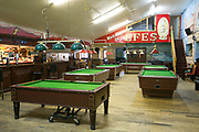 Pool tables at Efes Snooker Club on 18th November 2015 in East London, United Kingdom. A popular, rough and ready, Turkish Snooker and Pool hall, popular with young hipsters in Dalston.