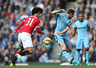 Marouane Fellaini of Manchester United tackles James Milner of Manchester City - Barclays Premier League - Manchester City vs Manchester Utd - Etihad Stadium - Manchester - England - 2nd November 2014  - Picture David Klein/Sportimage