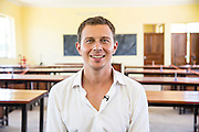 VSO volunteer Paul Jennings   in one of the classrooms of Angaza school, Lindi, Tanzania