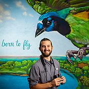 John Brush in front of a mural of a Green Jay at Quinta Mazatlan in McAllen, Texas. Nathan Lambrecht/Journal Communications
