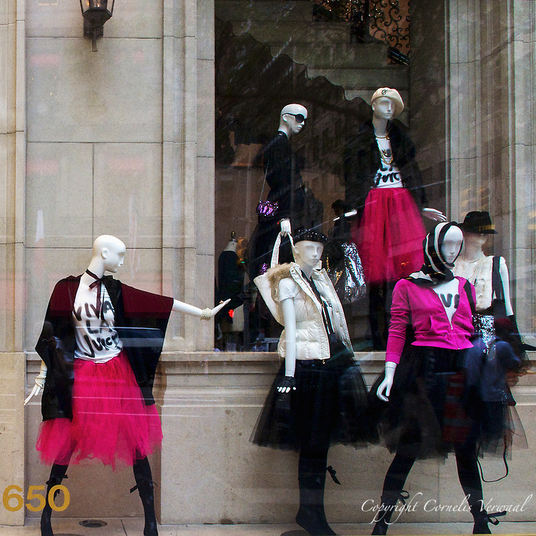 Stylish mannequins at Juicy Couture keep an eye on the tourists along Fifth Avenue, New York City