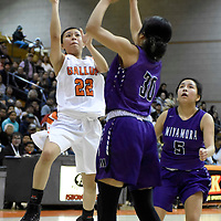 Photo: Jeffery Jones - Feb 27, 2019<br /> Gallup Lady Bengal Kennedy Smiley (22) shoots the ball over Miyamura Lady Patriot Malia Ukestine (30) during Wednesday's district play-off game at Gallup High School. The Lady Bengals won 50-39.