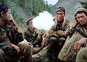 Porters taking a smoke break. The Humla Karnali Valley, Humla District, Nepal.