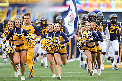 Sep 8, 2018; Morgantown, WV, USA; The West Virginia Mountaineers cheerleaders lead the team onto the field prior to their game against the Youngstown State Penguins at Mountaineer Field at Milan Puskar Stadium. Mandatory Credit: Ben Queen-USA TODAY Sports