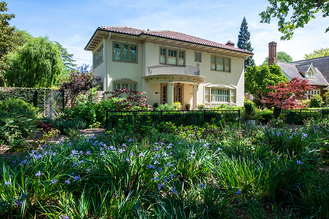 A home garden in the Fabulous 40s area of Sacramento, California, features drought tolerant irises with purple flowers in their front yard. Photo taken April 27, 2019.  Florence Low / California Department of Water Resources, FOR EDITORIAL USE ONLY