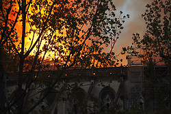 Smoke and flames rise during a fire at the landmark Notre-Dame Cathedral in central Paris on April 15, 2019, potentially involving renovation works being carried out at the site, the fire service said. Photo by Raul Benegas/ABACAPRESS.COM