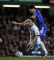 Photo: Paul Thomas.<br /> Chelsea v Wycombe Wanderers. Carling Cup, Semi Final 2nd Leg. 23/01/2007.<br /> <br /> Michael Ballack (R) of Chelsea fouls Stefan Oakes.