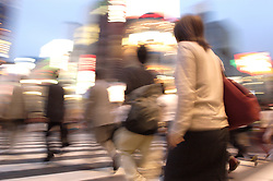 Many pedestrians cross street in evening at Ginza Tokyo