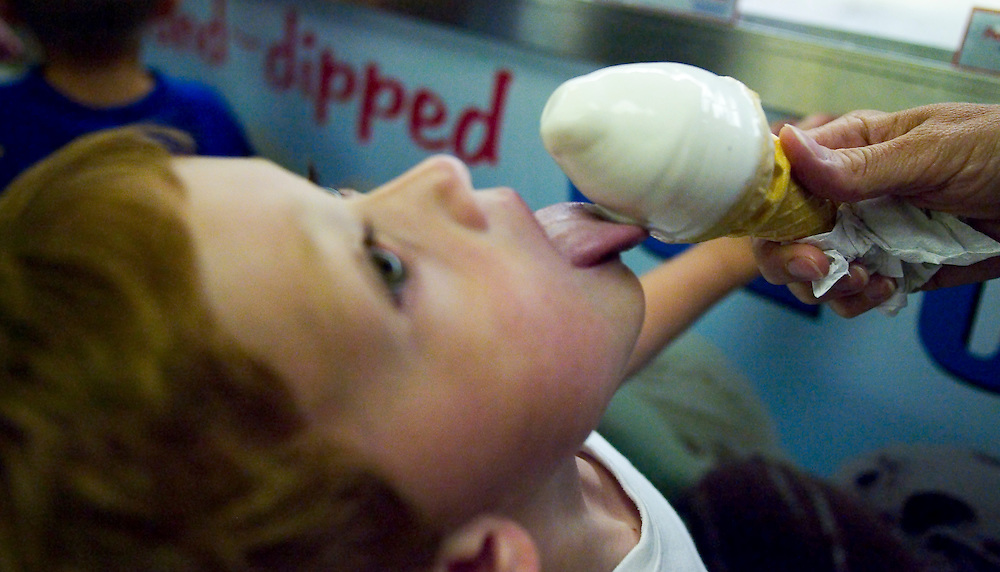 (DAYIN) Lavallett 7/72004    Kevin Seitter 5 of Seaside Park takes a lick of a ice cream cone held by him mom Diane at Salty's Ice Cream Shop.  Michael J. Treola Staff Photographer....MJT