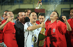 Ermin Rakovic, captain of Interblock with a champaign, at left club president Joc Pececnik, Suvad Grabus, right Erik Salkic,  at Slovenian Supercup between NK Domzale and NK Interblock, on July 9, 2008, in Domzale. Interblock won the mach and Supercup by 7 : 6 after penalty shots. (Photo by Vid Ponikvar / Sportal Images)
