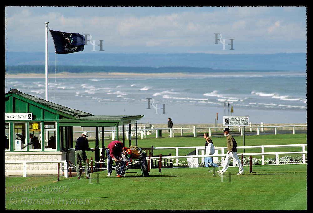 Golfers prepare to tee off at the first hole of world-famous Old Course at St. Andrews Links. Scotland