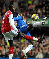 Photo: Ed Godden.<br /> Chelsea v Arsenal. The Barclays Premiership. 10/12/2006.<br /> Chelsea's Geremi (R), reaches the ball before Emmanuel Adebayor.