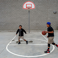 Cain Yazzie, right, and Coltin Bradley play a game of one-on-one basketball at Crownpoint Elementary School April 8.