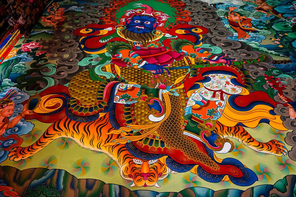 Buddhist murals, Songzanlin (Ganden Sumtsenling) Monastery, Shangri La, Yunnan Province, China. It is the largest Tibetan Buddhist monastery in Yunnan Province.