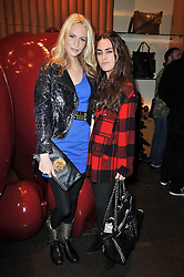 Left to right, POPPY DELEVINGNE and TALLULAH ORMSBY-GORE at a party to celebrate the launch of the new Mulberry leather case for Apple's iPhone held at the Mulberry store, Bond Street, London on 5th November 2009.