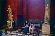 Saint Petersburg, Russia, June 2002..Two school visitors take a break in the Hermitage Museum?s classical section. The Hermitage, former home of the Tsars, is one of the world's great museums..