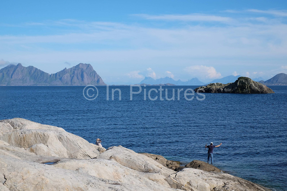 Coastal sea fishing in the village of Kabelvag on 22nd August 2016, Lofoten, Norway. The Lofoten islands are famous for their jagged mountains, red-painted rorbu cabins and racks with fish hanging closely packed to dry.