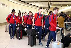 England U17's walk through the terminal as they arrive back to the UK, at Heathrow Airport.