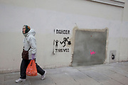 London, UK. Saturday 23rd February 2013. People pass the site of the Wood Green Banksy in North London. The iconic artwork was removed from this site and will go on sale in Miami and is expected to reach an estimated £500,000. Local people are protesting and campaigning to stop the ale.
