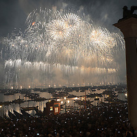 VENICE, ITALY - JULY 19:  Party goers on gondolas and boats admire the fireworks over the St. Mark's Basin for the Redentore Celebrations on July 19, 2014 in Venice, Italy. Redentore , which is in remembrance of the end of the 1577 plague, is one of Venice's most loved celebrations. Highlights of the celebration include the pontoon bridge extending across the Giudecca Canal, gatherings on boats in the St. Mark's Basin and a spectacular fireworks display.  (Photo by Marco Secchi/Getty Images)