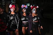 New York, NY - 31 October 2019. the annual Greenwich Village Halloween Parade along Manhattan's 6th Avenue. Three women dressed as calavera catrinas.