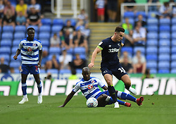 Reading's Sone Aluko and Derby County's Tom Lawrence battle for the ball