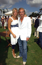 ISABELLA ANSTRUTHER-GOUGH-CALTHORPE and her brother JACOBI ANSTRUTHER-GOUGH-CALTHORPE at the Cartier International polo at Guards Polo Club, Windsor Great Park, on 30th July 2006.<br />