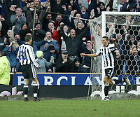 Photo. Andrew Unwin.<br /> Newcastle United v Charlton Athletic, FA Barclaycard Premier League, St James Park, Newcastle upon Tyne 20/03/2004.<br /> Newcastle's Jermaine Jenas (r) runs to celebrate his goal with team-mate Laurent Robert (l).