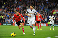 Angel Rangel of Swansea City is chased by Cardiff's Craig Bellamy.<br /> Barclays Premier League match, Cardiff city v Swansea city at the Cardiff city stadium in Cardiff, South Wales on Sunday 3rd Nov 2013. pic by Phil Rees, Andrew Orchard sports photography,