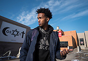 Mohamed Warsame, president of the Somali Student Association, stands by a banner that has hung on campus for years at St. Cloud State University in St. Cloud, Minnesota, Tuesday December 20, 2016. Warsame is proud of the vast diversity among the student body, and he feels safe in the progressive university community. The city feels different, he says.