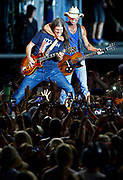 Kenny Chesney, right, cuts up with guitarist Kenny Greenberg as they perform during a concert at Nissan Stadium Saturday, Aug. 11, 2018 in Nashville, Tenn.
