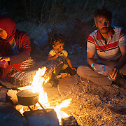 Leila 31, Jorahan 35 and one their kids from Kunduz Afghanistan boiling water to make tea in Kara Tepe camp.