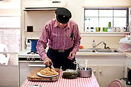 """Lawrence """"Shine"""" Thornton, of Maria's Famous Hot Tamales, serves tamales at his home in Greenville, Mississippi."""