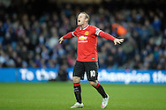 Wayne Rooney, the Manchester United captain shouts at his players. Barclays Premier league match, Queens Park Rangers v Manchester Utd at Loftus Road in London on Saturday 17th Jan 2015. pic by John Patrick Fletcher, Andrew Orchard sports photography.