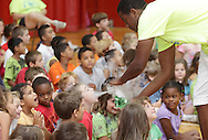 Middletown, New York - A camp counselor directs a stream of carbon dioxide gas from a beaker full of water and dry ice at a camper during a Mad Science demonstration at Middletown YMCA summer camp on Aug. 20, 2010.