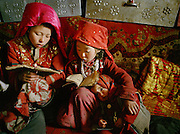 Girl learning to read Koran at Haji Osman:Bibi Hawa (11 yrs old), Marbet (6) and Chechen Gul (7). They start learning at 6 years old. They are taught only in winter 3 months/year..Campment of Tshar Tash (Haji Osman's camp), in the Wakhjir valley, at the source of the Oxus..Winter expedition through the Wakhan Corridor and into the Afghan Pamir mountains, to document the life of the Afghan Kyrgyz tribe. January/February 2008. Afghanistan